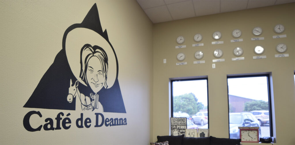 Image of Deanna's Java Station in Clinton Iowa. Logo at the wall reads: Café de Deanna