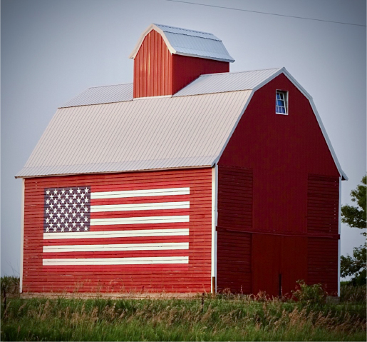 Red barn with the US flag on a wall